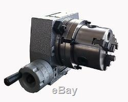 The adapter and 3 jaw chuck for mounting on a 4 rotary table